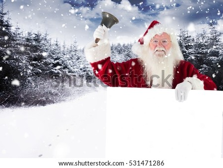 Santa claus ringing a bell while holding placard against digitally generated background