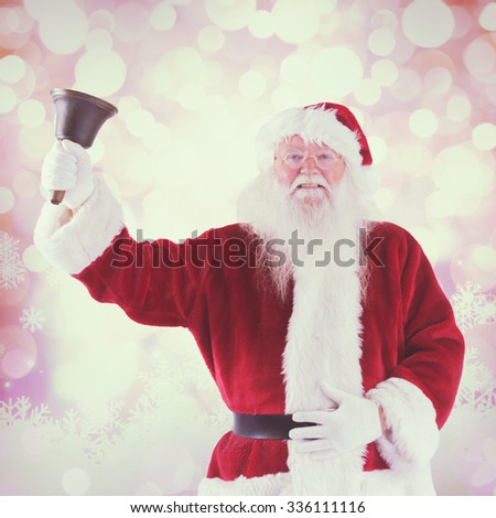 Santa Claus rings his bell against glowing christmas background