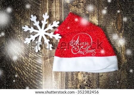 Santa Claus's cap and Inscription merry Christmas - stock photo