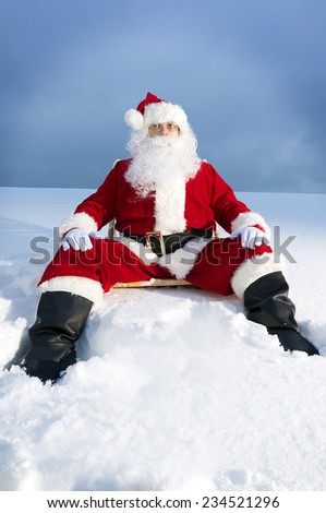 Santa Claus sitting looking at camera tired
