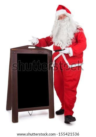 Santa Claus standing beside advertising board - stock photo