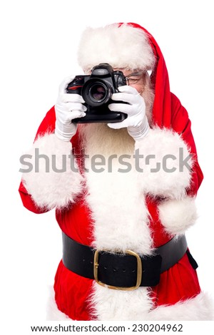 Santa claus taking photos with his new camera  - stock photo