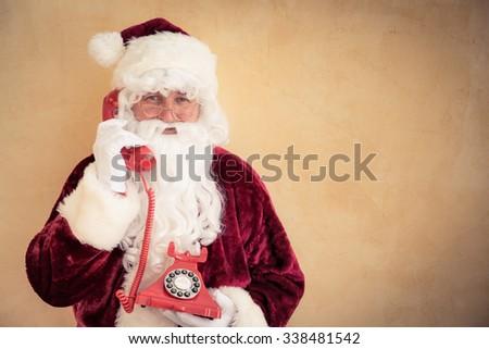 Santa Claus talking on phone. Christmas holiday concept - stock photo