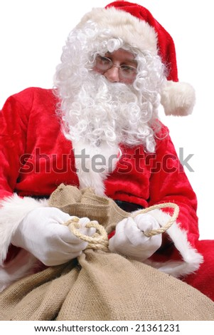 Santa Claus tying up big jute sack full of christmas presents over white