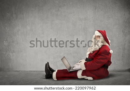 Santa Claus uses technology  - stock photo