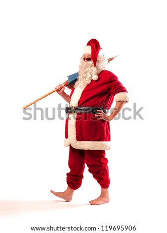 Santa Claus walking with a beach umbrella - stock photo