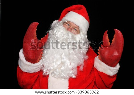 Santa Claus wears Lobster Claw Hands while posing in a PHOTO BOOTH for a funny picture. - stock photo