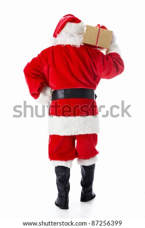 Santa Claus with a gift isolated - stock photo