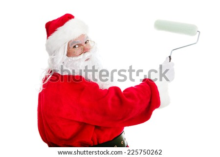 Santa Claus with a paint roller, working on a home improvement project.  Isolated on white.   - stock photo