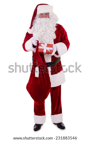 Santa Claus with bag and gift box. Isolated on white background - stock photo