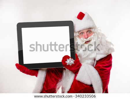 Santa Claus with big tablet on white background. Isolated - stock photo