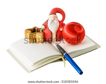 Santa Claus with Christmas decorations in the diary isolated on a white background - stock photo