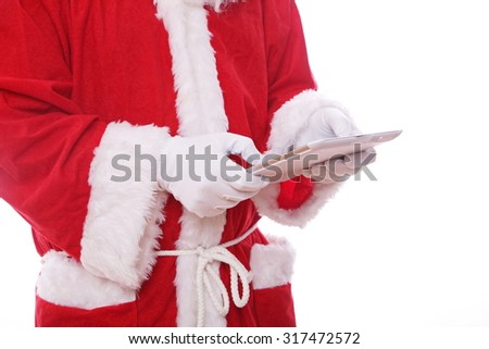 santa claus with digital tablet. isolated on the white background - stock photo