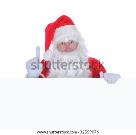 Santa Claus With Finger Pointing up Holding a Blank Sign isolated on white