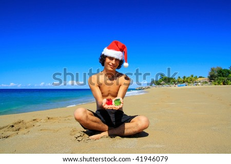 Santa Claus with gift boxes on beach