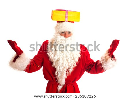 Santa Claus with gift on his head. Isolated on white. - stock photo