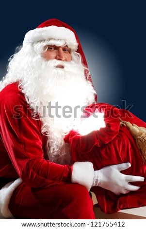 Santa Claus with his magic gift red bag full of presents