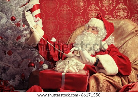 Santa Claus with presents and New Year tree at home. Christmas. - stock photo