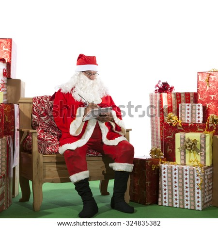 Santa Claus Writing a List of Gifts - stock photo