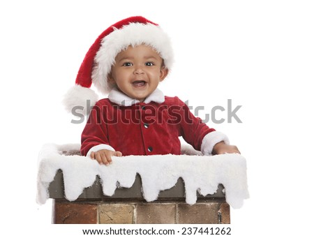 Santa Clause.  Adorable baby dressed as Santa Clause and standing in a chimney.  Isolated on white with room for your text. - stock photo