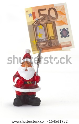Santa clause figurine with fifty Euro on white background - stock photo