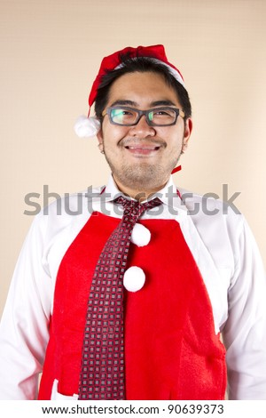 Santa Costume, Businessman wear Santa red tie, red apron, red hat smiling.