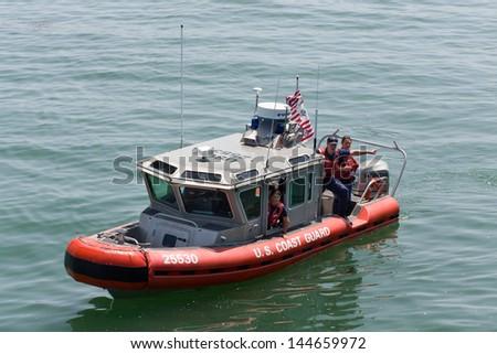 SANTA CRUZ, CA/USA - JUNE 30: Unidentified agents of the U.S. Coast Guard patrol the Santa Cruz Harbor.  The Coast Guard is part of the  U.S. Department of Homeland Security.  June 30, 2013 - stock photo