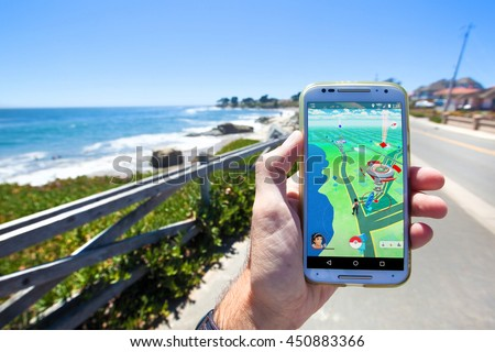 "SANTA CRUZ, CALIFORNIA - JULY 10, 2016: The hit augmented reality smartphone app ""Pokemon GO"" shows the game map based on real-world landmarks around the player's location. - stock photo"