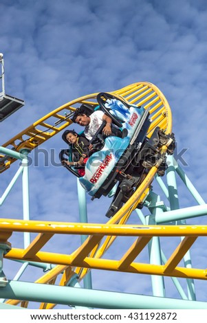 SANTA CRUZ, CALIFORNIA, USA-NOVEMBER 15, 2014 : People on Northern`s California only spinning coaster. Track lenght 1410 ft and maximum speed is up to 40 mph. Taken in Santa Cruz Beach Boardwal Park