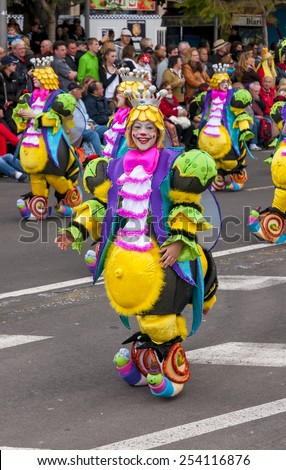 "SANTA CRUZ DE TENERIFE, SPAIN - FEBRUARY 18: Clowns of the Carnival during the ""Coso"" or ""Final Parade"" on February 18, 2015 in Tenerife (Canary Islands) Spain."