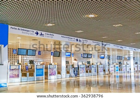 Santa Cruz, Madeira - June 9, 2013: Check-in at airport of the island Madeira. Man standing at the counter talking to ground staff.  - stock photo