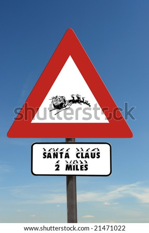 Santa Driving Sleigh warning roadsign over blue sky