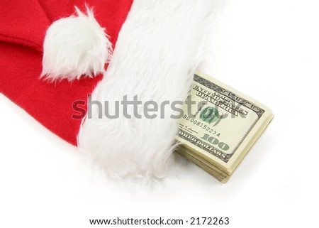 Santa furry red  hat and us dollar with white background - stock photo