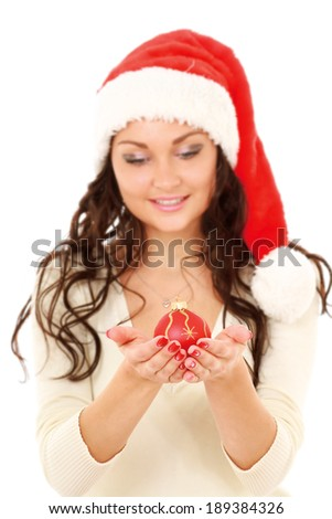 Santa girl holding a Christmas ball,isolated on white background - stock photo
