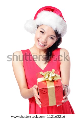 Santa girl holding christmas gift. Young happy woman in santa hat showing Christmas present isolated on white background. model is a asian girl