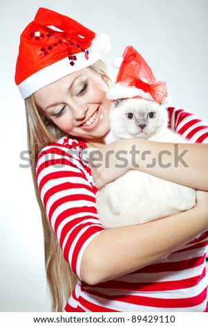 Santa girl. Santa cat - stock photo