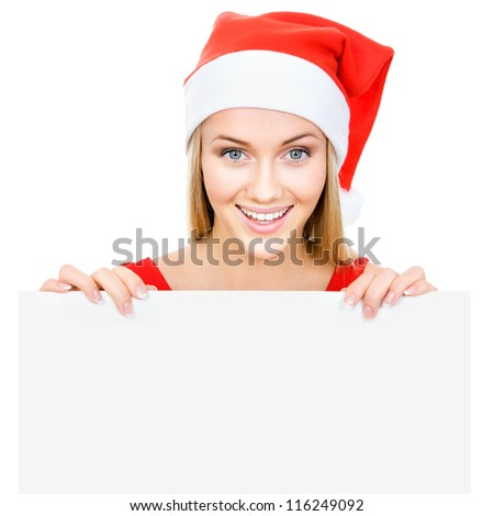 Santa girl wearing Christmas Chat and shows a white space - stock photo