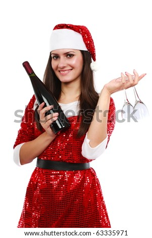 Santa girl with a bottle of wine and two glasses isolated on white background - stock photo
