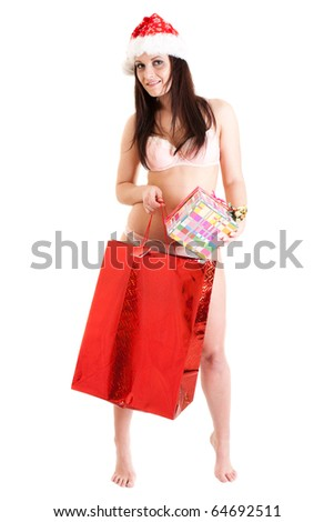 Santa girl with red bag and present - stock photo