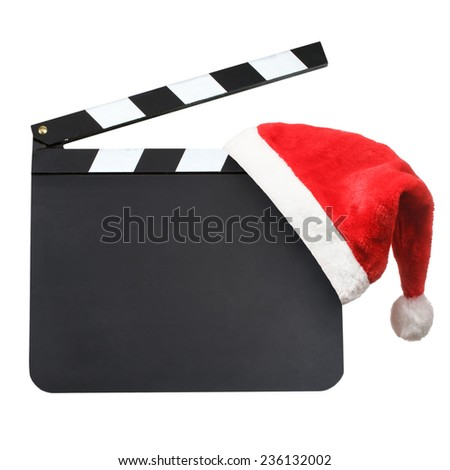 Santa hat hanging on blank movie clapper board. Christmas entertainment concept - stock photo