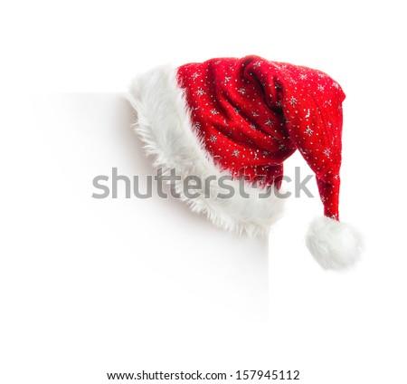 Santa hat hanging on white board - stock photo