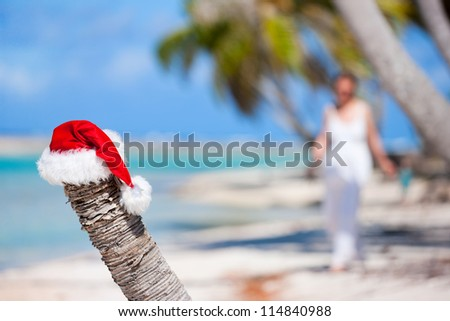 Santa hat on a beach at tropical island