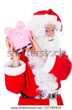 Santa holding piggy bank on white background - stock photo