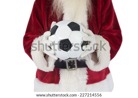 Santa holds a classic football on white background - stock photo