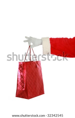santa holds a red gift bag isolated on white