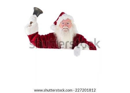 Santa holds a sign and rings his bell on white background - stock photo