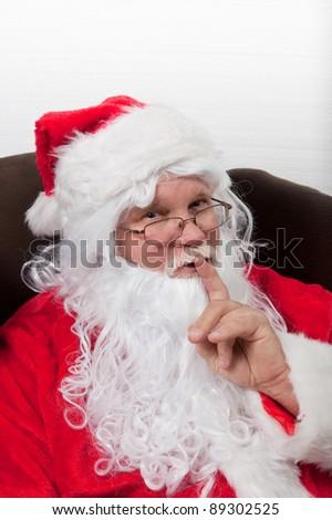 Santa Knows a Secret - stock photo