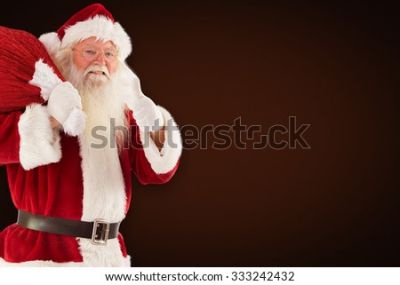 Santa likes to carry his sack against orange background with vignette - stock photo