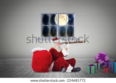 Santa looking through telescope against grey room - stock photo