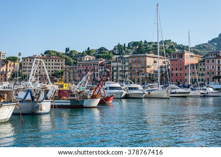 SANTA MARGHERITA LIGURE , ITALY - AUGUST 2014: Fisherman and pleasure boats in harbour